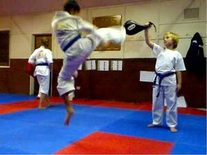 Luke Mathias of Branca Taekwondo training his jumping roundhouse.