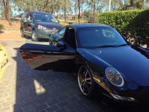 True Local: Clean Freak Mobile Detailing Image - Machine polish results on this Porsche!