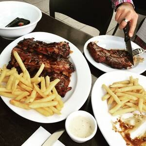 True Local: Hurricane's Grill & Bar Image - Lamb ribs, rib-eye and chips