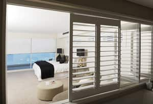 True Local: Sublime Shutters & Blinds Image - Bifolding Plantation Shutters and Roll Blinds by Sublime