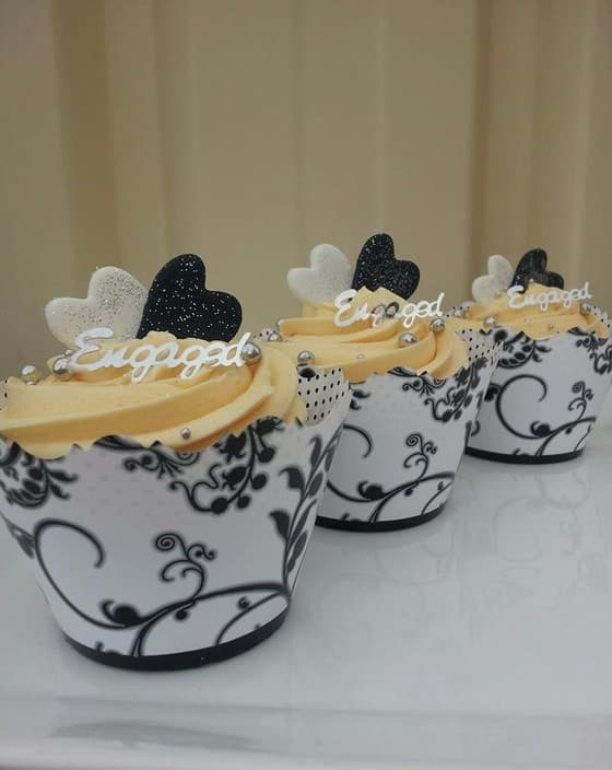Cupcake Princess Pic 1 - Classic Vanilla Cupcakes with hand made black white fondant hearts soft sugar silver pears with french wraps
