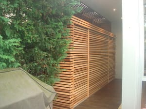 Emerald Building & Carpentry Services Pic 5 - Outside storage unit finished using cedar timber screening on a black backing board