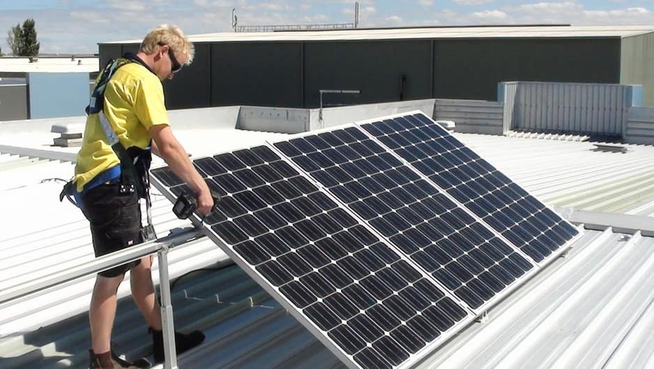 United Renewable Energy Pic 1 - Installation of our Blueline AC Modules with integrated Microinverters