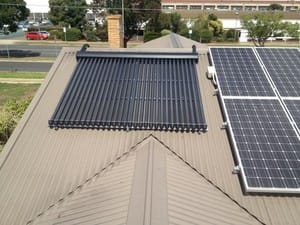 United Renewable Energy Pic 2 - Solar Hot Water Tubes and a Solar PV System