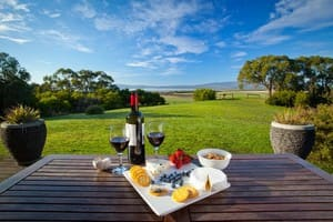 Coastal View Cabins Pic 5 - Enjoy some local wine and cheese from your private balcony