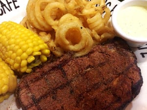 Hog's Breath Cafe Pic 4 - Blackened prime rib medrare with hog tail fries corn Bernaise sauce Good stuff