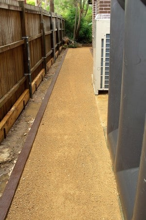 McDevitt Landscapes Pic 4 - Stabilized deco granite path retained using common house bricks rendered using dark brown oxide