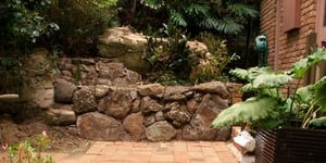 McDevitt Landscapes Pic 5 - Exclusive Volcanic Bush Rock Looks fantastic around garden beds pool surrounds ponds and within waterfalls