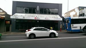 Top Health Medical Centre Pic 4 - street view just beside a bus station