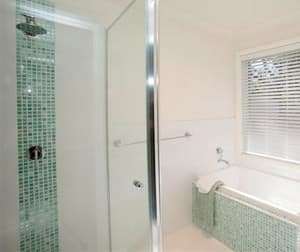 Love & Adorn Interiors Pic 4 - green mosaic main bathroom