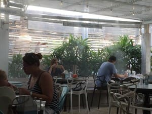 Cafe Le Monde Pic 3 - Water mists blow through the cafe keeping everyone cool