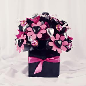 Yummy Flowers Brisbane Pic 3 - A stunning hot pink and black chocolate bouquet with 30 chocolates including exclusive raspberry lindt balls Sure to leave her smiling