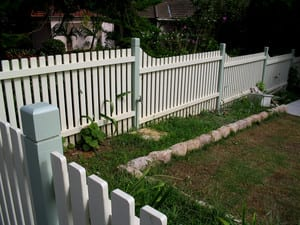 Pride Fencing. Pic 2 - graded painted picket fence