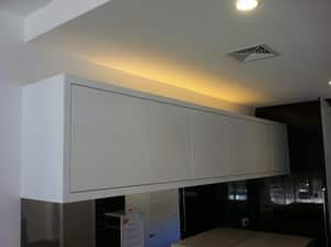 TSJ Electrical Pic 4 - Installation of strip lighting above cupboard