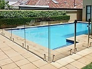 Dunn & Farrugia Fencing and Gates Pic 1 - Pool Glass fencing with aluminium spigotts