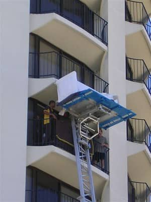 King Hoists Pic 2 - a sofa being unloaded onto a balcony